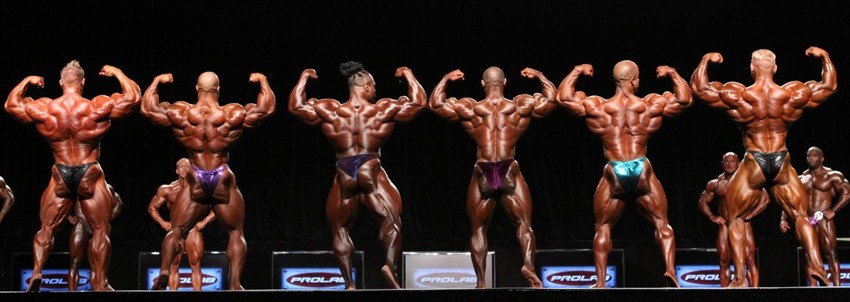 http://www.evolutionofbodybuilding.net/wp-content/uploads/2013/07/Olympia-line-up.jpg