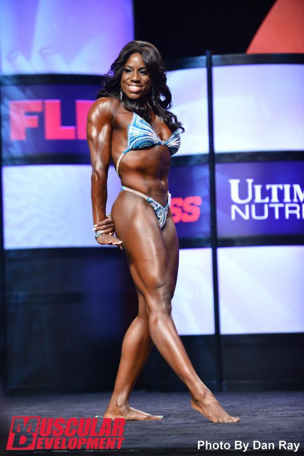 Juliana Malacarne wins the 2014 Olympia IFBB Pro Women's