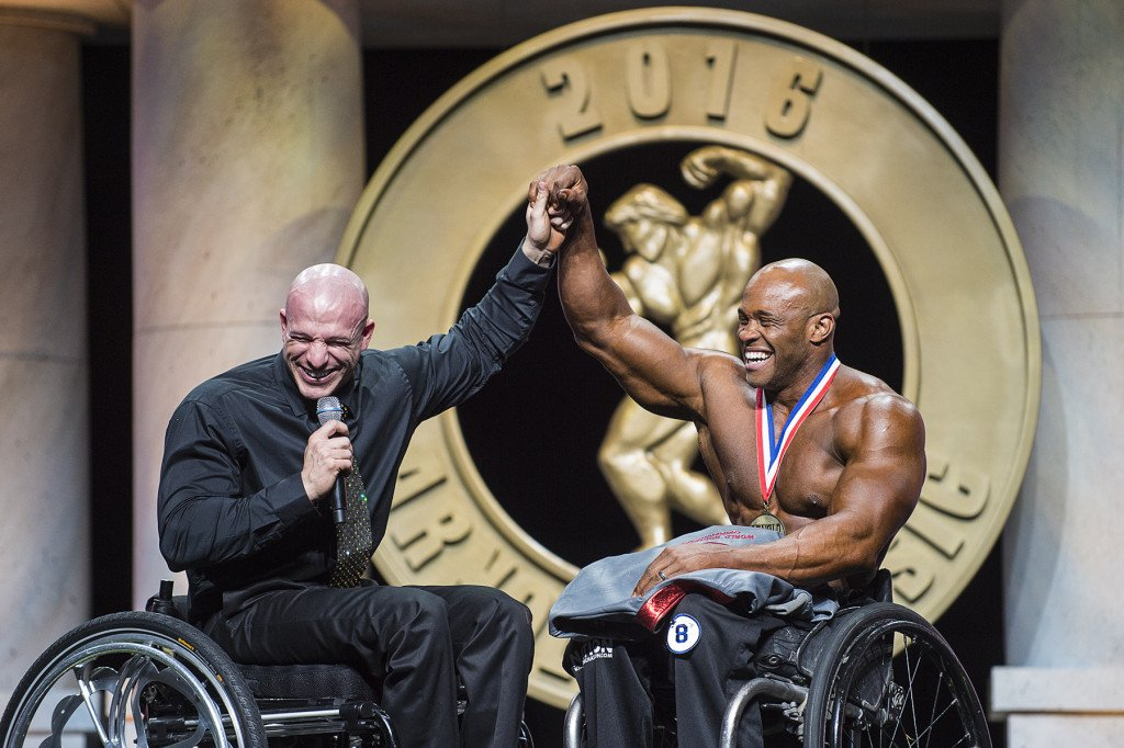 Arnold Classic Pro Wheelchair winner Harold Kelley (right) with event Director Nick Scott (left)