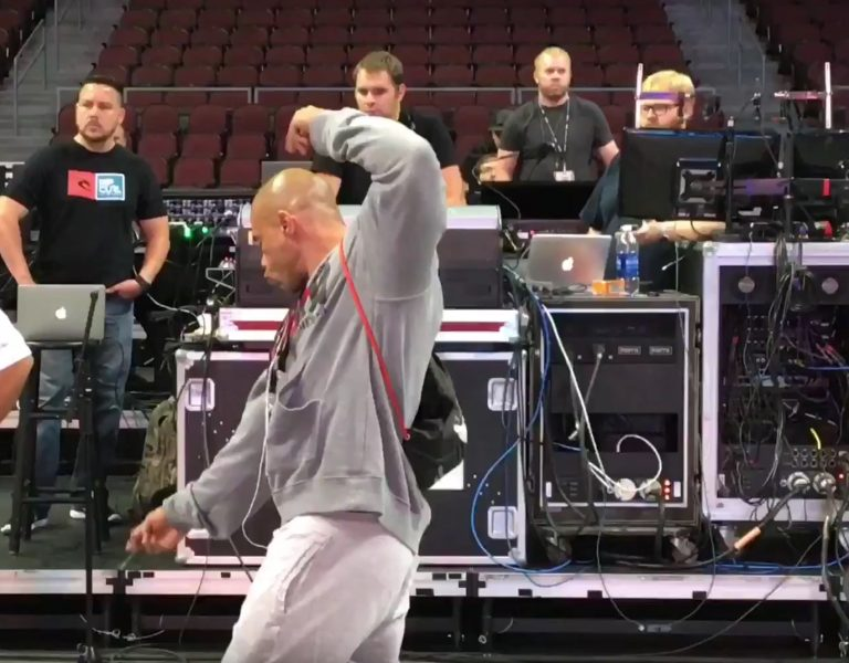 Kevin Levrone inspects the Mr. Olympia stage and hits some poses