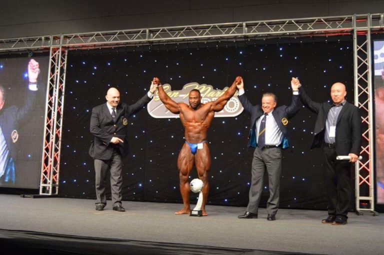 Michael Muzo wins the 2016 IFBB Amateur Olympia Men's Bodybuilding overall title in San Marino
